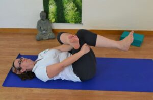Practising the reclining hip opener asana at La Crisalida Retreats, Spain